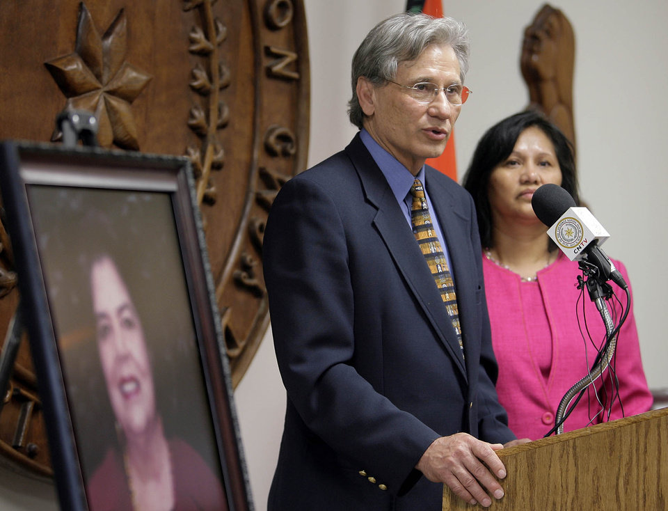 Photo - DEATH: Chad Smith, principal chief of the Cherokees, stands with his wife Bobby Gail as he gives remarks next to a portrait of his friend and former chief Wilma Mankiller during a press conference at the Cherokee Nation headquarters in Tahlequah, OK, April 6, 2010. Mankiller died earlier in the day after a long battle with cancer. MICHAEL WYKE/Tulsa World ORG XMIT: DTI1004061607560179