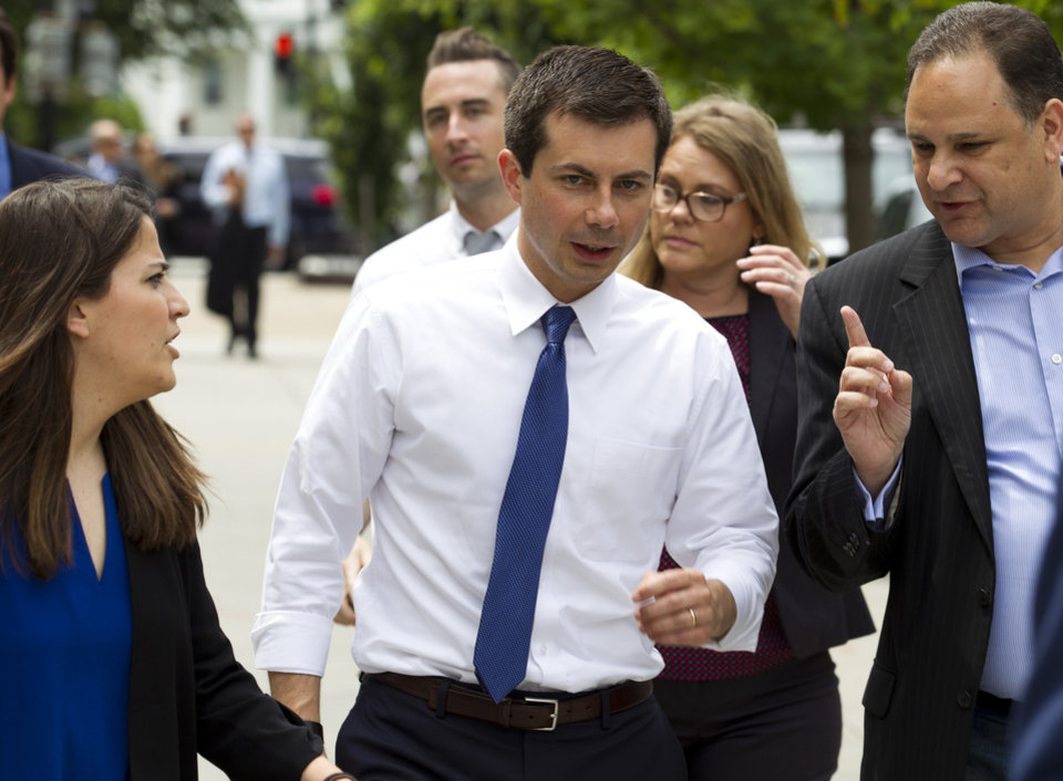 Photo -  Democratic presidential candidate Mayor Pete Buttigieg, walks to his car after attending a rally, protesting against President Donald Trump policies outside of the White House in Washington, Wednesday, June 12, 2019. (AP Photo/Jose Luis Magana)