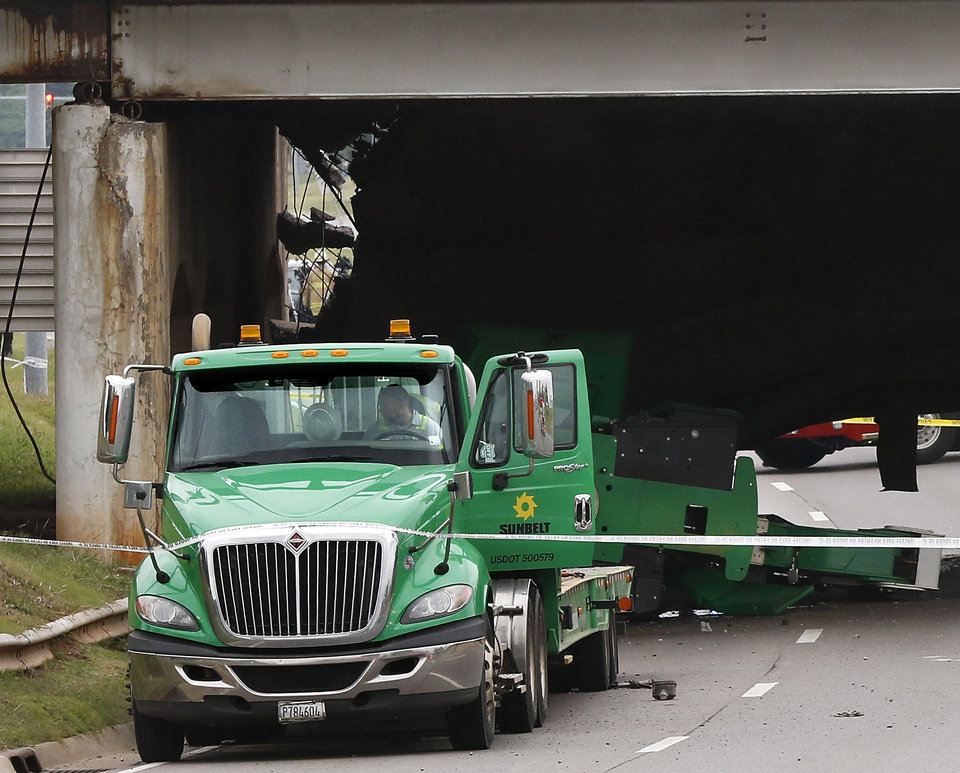 Photo - A truck carrying unknown cargo is parked on the west edge of the bridge after the bridge collapsed. The trailer's payload was damaged after it toppled from the truck bed onto the street. A section of the May Ave. bridge above the Northwest Expressway collapsed when  it was hit by a truck Thursday afternoon, in  Oklahoma City. No injuries were reported. Photo by Jim Beckel, The Oklahoman.