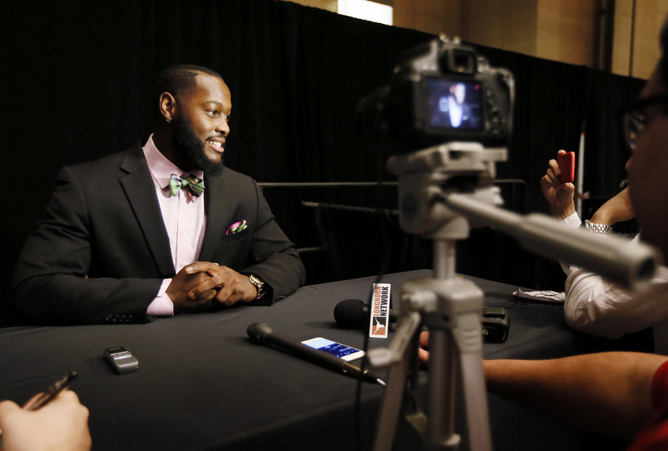 Photo - Texas Tech defensive lineman Branden Jackson smiles as he talks with reporters at Big 12 Conference Football Media Days, Monday, July 20, 2015, in Dallas. (AP Photo/Tony Gutierrez)