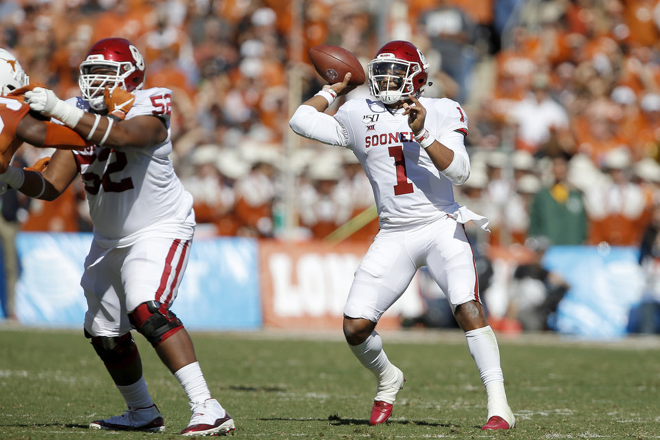 Photo - Oklahoma's Jalen Hurts (1) throws a pass during the Red River Showdown college football game between the University of Oklahoma Sooners (OU) and the Texas Longhorns (UT) at Cotton Bowl Stadium in Dallas, Saturday, Oct. 12, 2019. Oklahoma won 34-27. [Bryan Terry/The Oklahoman]