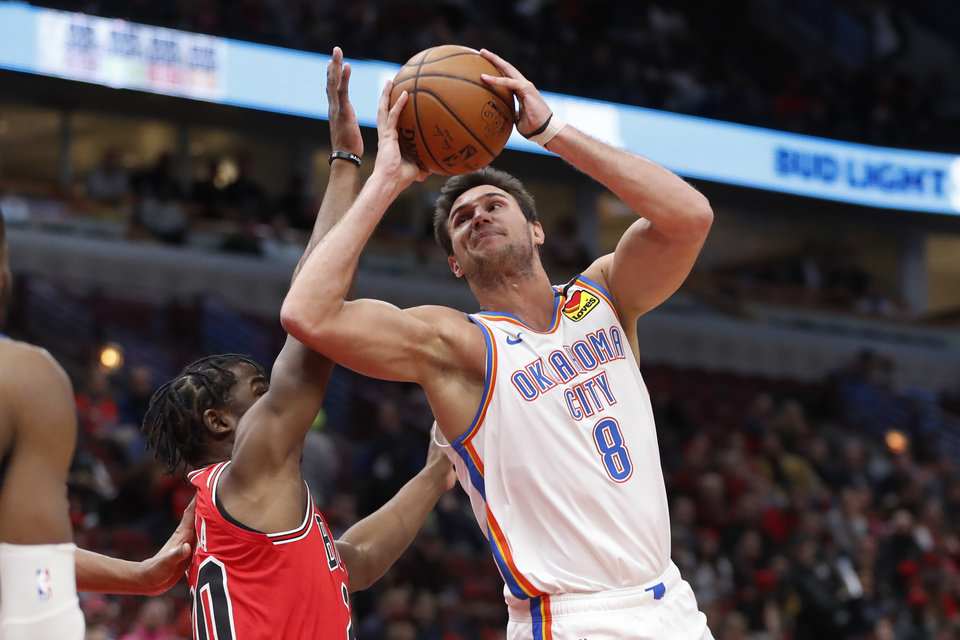 Photo - Oklahoma City Thunder's Danilo Gallinari (8) shoots over Chicago Bulls' Adam Mokoka during the first half of an NBA basketball game Tuesday, Feb. 25, 2020, in Chicago. (AP Photo/Charles Rex Arbogast)