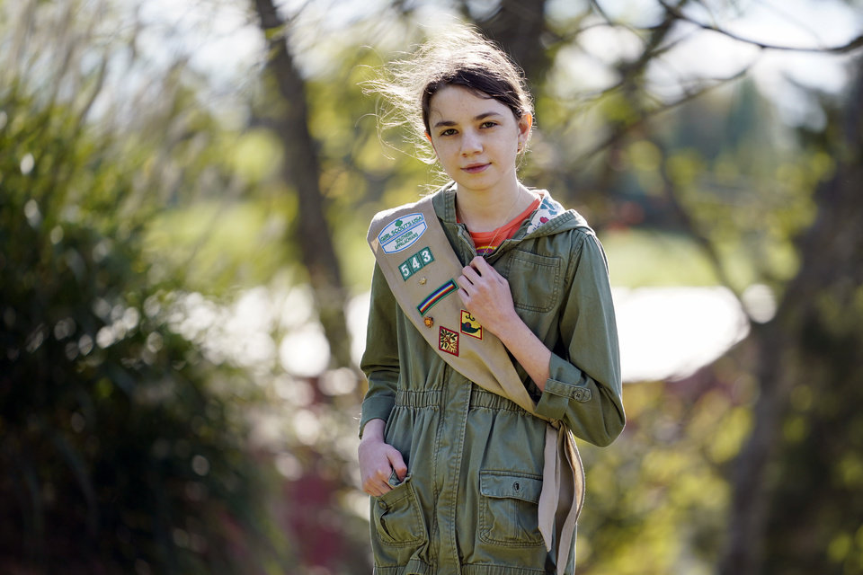 Photo -  Olivia Chaffin, 14, stands for a portrait with her Girl Scout sash in Jonesborough, Tenn., on Sunday, Nov. 1, 2020. Olivia is asking Girl Scouts across the country to band with her and stop selling cookies, saying,
