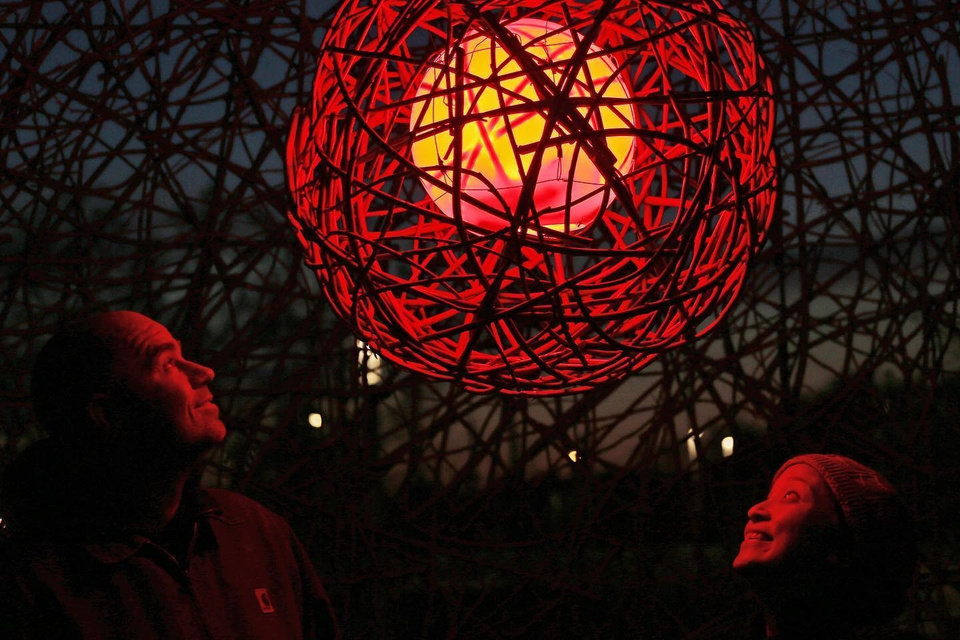 "Photo -  Denise Duong, right, and Gabriel Friedman created the installation ""The Unexpected Us"" at Scissortail Park as part of the ""Bright Golden Haze: Reflections"" program celebrating the new Oklahoma Contemporary Arts Center. [Doug Hoke/The Oklahoman]"