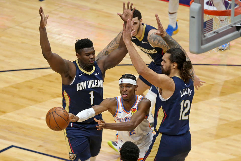 Photo - Jan 6, 2021; New Orleans, Louisiana, USA; Oklahoma City Thunder guard Shai Gilgeous-Alexander (2) passes the ball while defended by New Orleans Pelicans forward Zion Williamson (1) and center Steven Adams (12) in the first quarter at the Smoothie King Center. Mandatory Credit: Chuck Cook-USA TODAY Sports