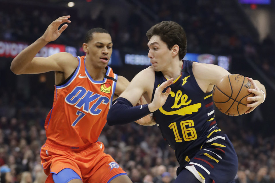 Photo - Cleveland Cavaliers' Cedi Osman (16) drives past Oklahoma City Thunder's Darius Bazley (7) in the first half of an NBA basketball game, Saturday, Jan. 4, 2020, in Cleveland. [AP Photo/Tony Dejak]