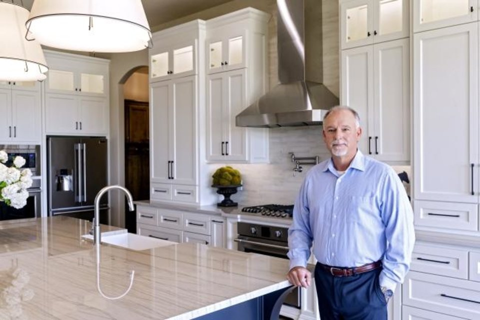 Photo -  Homebuilder Craig Smith shows the kitchen at 2432 SW 127, one of the stops on the Gallery of Homes at Rivendell fundraiser through July 12. [CHRIS LANDSBERGER/THE OKLAHOMAN].