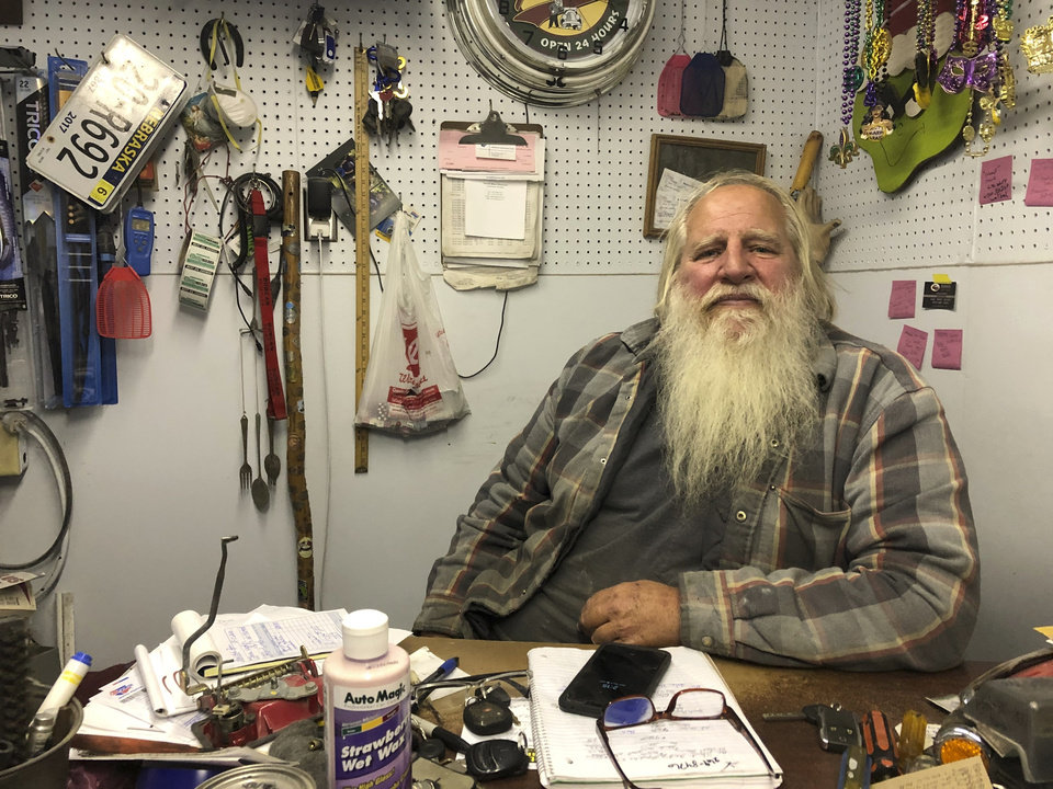Photo -  Danny Rice, 67, discusses the coronavirus in his auto repair shop Monday in downtown Elmwood, Nebraska. [Grant Schulte/the associated press]