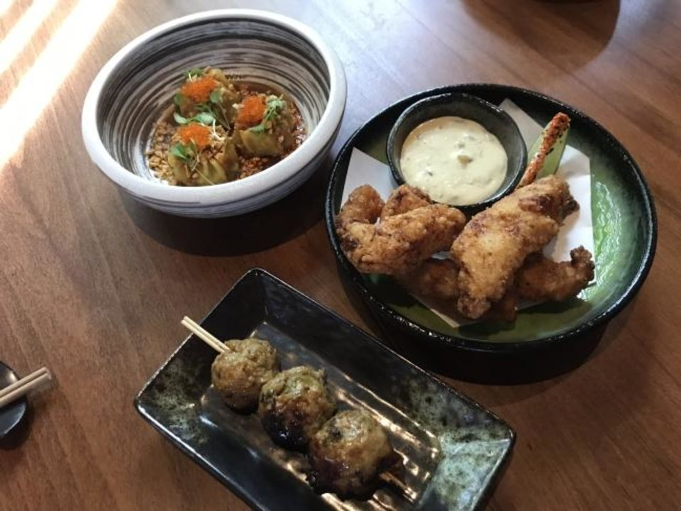 Photo -  Catfish, meatballls, and dumplings are specialities at Gun Izakaya, which opened in July 2019 in the Paseo Arts District. [Dave Cathey/The Oklahoman]