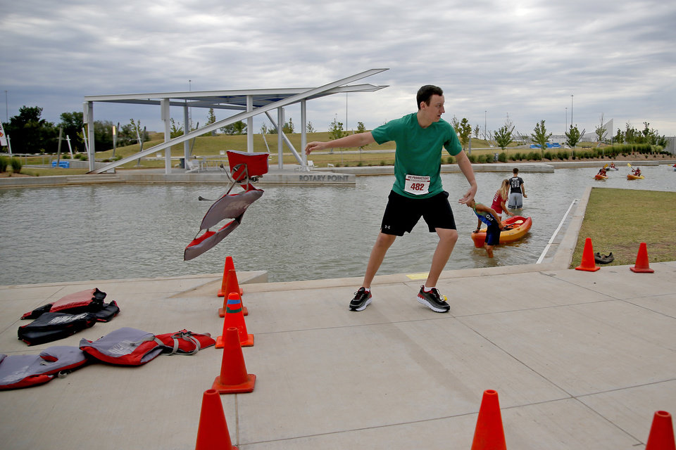 Photo -  Connor Castleberry starts his run during the kayak and 5k race.