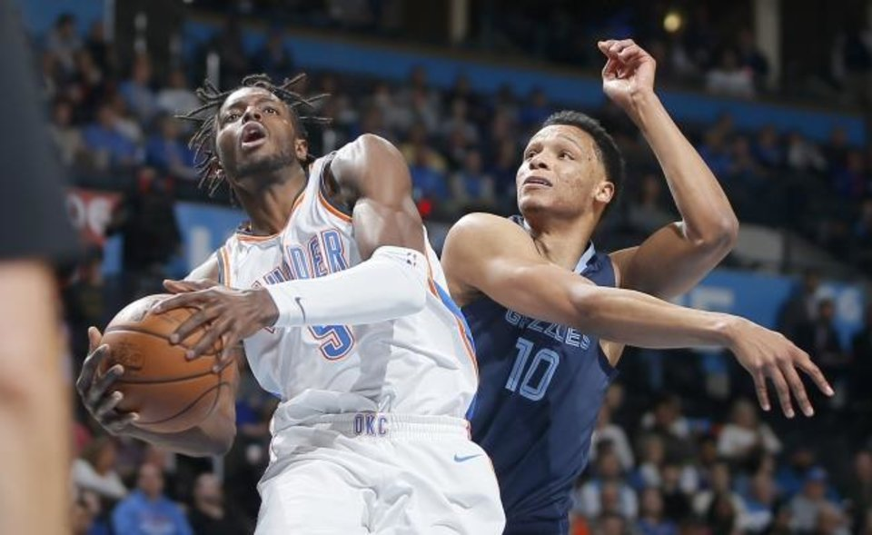 a2789e65e16 Oklahoma City s Jerami Grant (9) goes to the basket past Ivan Rabb (10) of  Memphis during an NBA basketball game between the Oklahoma City Thunder and  the ...