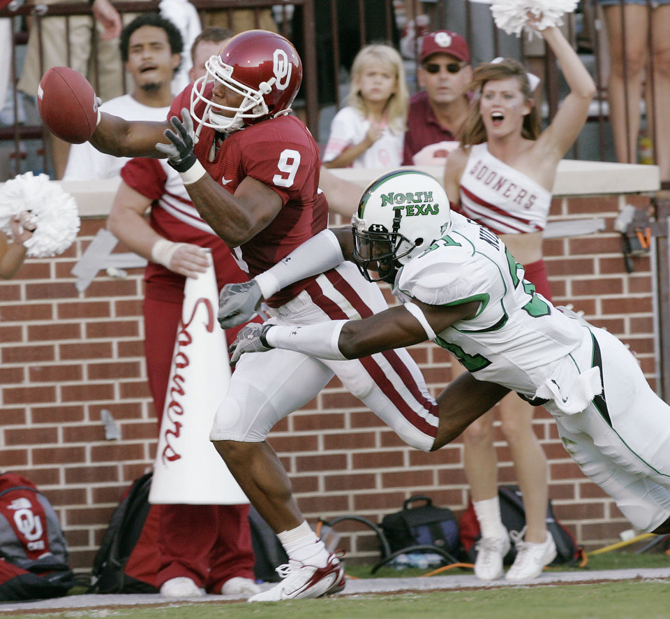 Photo - Oklahoma receiver Juaquin Iglesias (9) is knocked out of bounds at the 2-yard line after a 53-yard pass reception in the second quarter, by North Texas defender Latif Nurudeen (31) during the University of Oklahoma Sooners (OU) college football game against the University of North Texas Mean Green (UNT) at the Gaylord Family - Oklahoma Memorial Stadium, on Saturday, Sept. 1, 2007, in Norman, Okla.