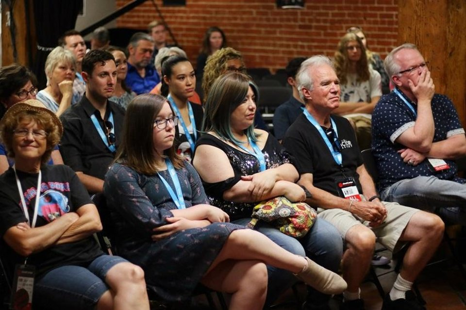 Photo - Attendees listen as Nathan Poppe questions Ryan Merriman, winner of one of the 2018 Oklahoma Film Icon awards, at a deadCenter Film Festival Panel hosted by the Oklahoma Film + Music Office, Saturday , June 9, 2018. [Doug Hoke/The Oklahoman Archives]