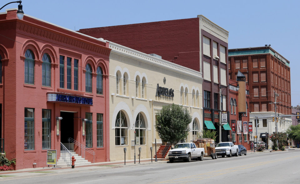 Photo - Looking east on Sheridan. From left: American Banjo Museum, Aueblo's, Bricktown Brewery and Spaghetti Warehouse. Thursday, July 24, 2014. Photo by Doug Hoke, The Oklahoman