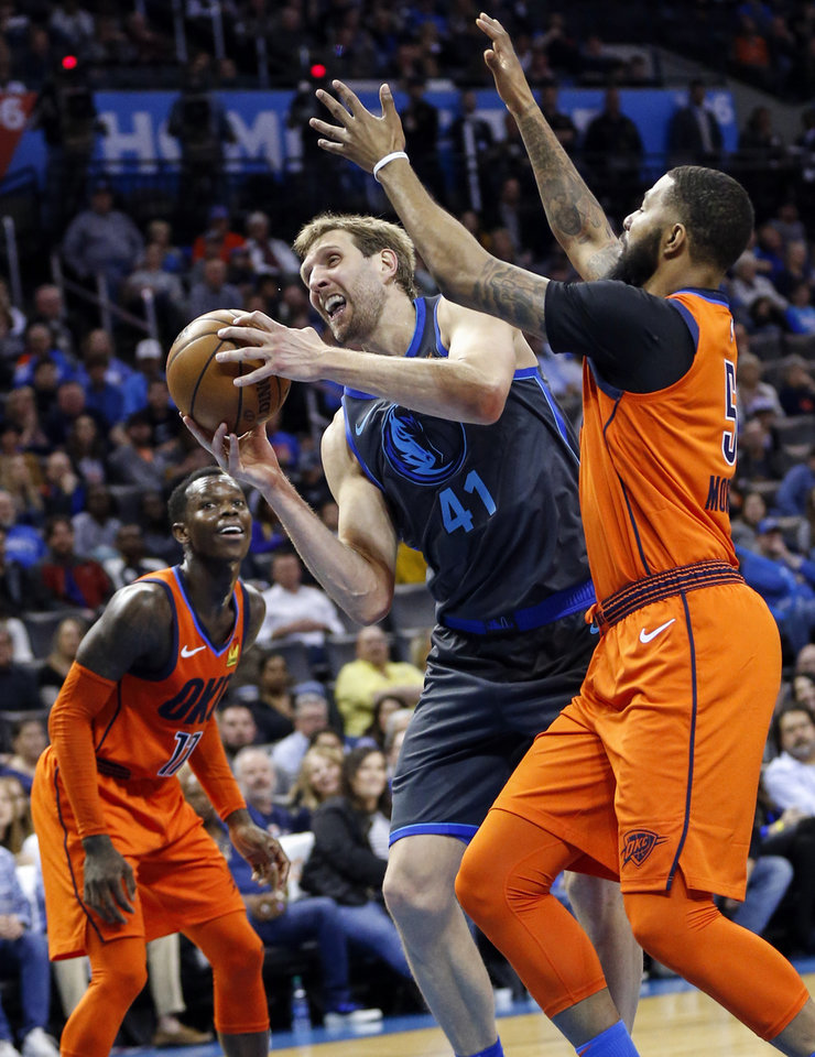 Photo - Dallas' Dirk Nowitzki (41) tries to score as Oklahoma City's Markieff Morris (5) defends and Dennis Schroder (17) looks on in the fourth quarter during an NBA basketball game between the Dallas Mavericks and the Oklahoma City Thunder at Chesapeake Energy Arena in Oklahoma City, Sunday, March 31, 2019. Dallas won 106-103. Photo by Nate Billings, The Oklahoman