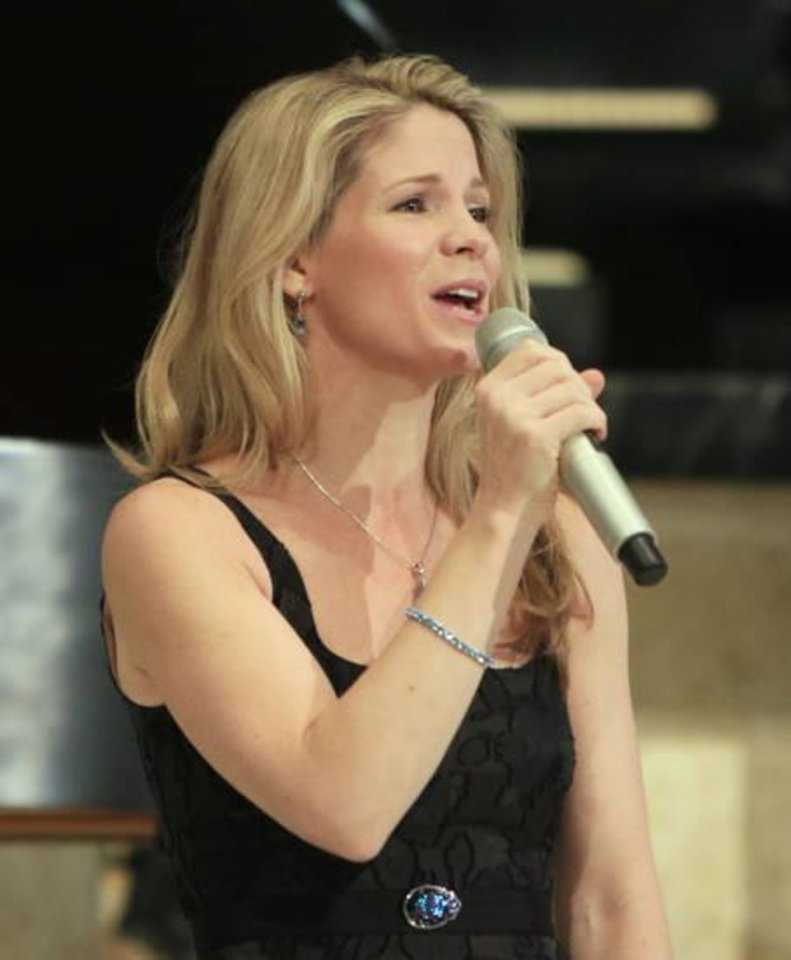 Photo - Tony Award Winner Kelli O'Hara sings during an Esther Women luncheon at St. Luke's United Methodist Church in Oklahoma City, OK, Tuesday, December 1, 2015. The Oklahoman Archives photo