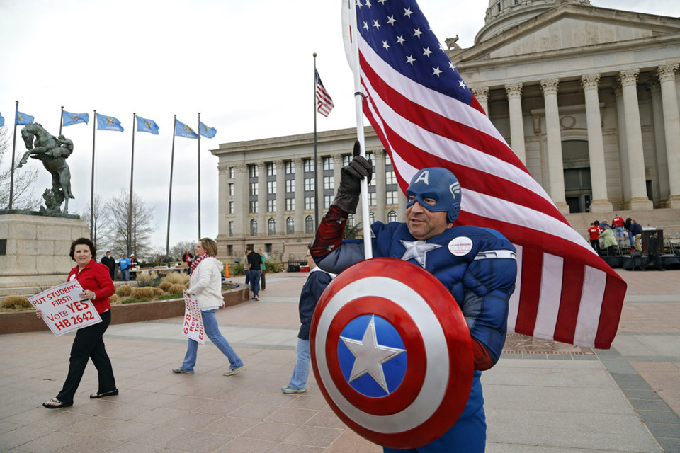 Photo - Super hero Captain America poses for a photo outside the capitol during a rally to appeal to lawmakers to make education funding a priority at the state capitol in Oklahoma City, Okla. on Monday, March 31, 2014. Educators, parents and community members from across Oklahoma gathered at the statehouse to make their voices heard by lawmakers. Photo by Jim Beckel, The Oklahoman