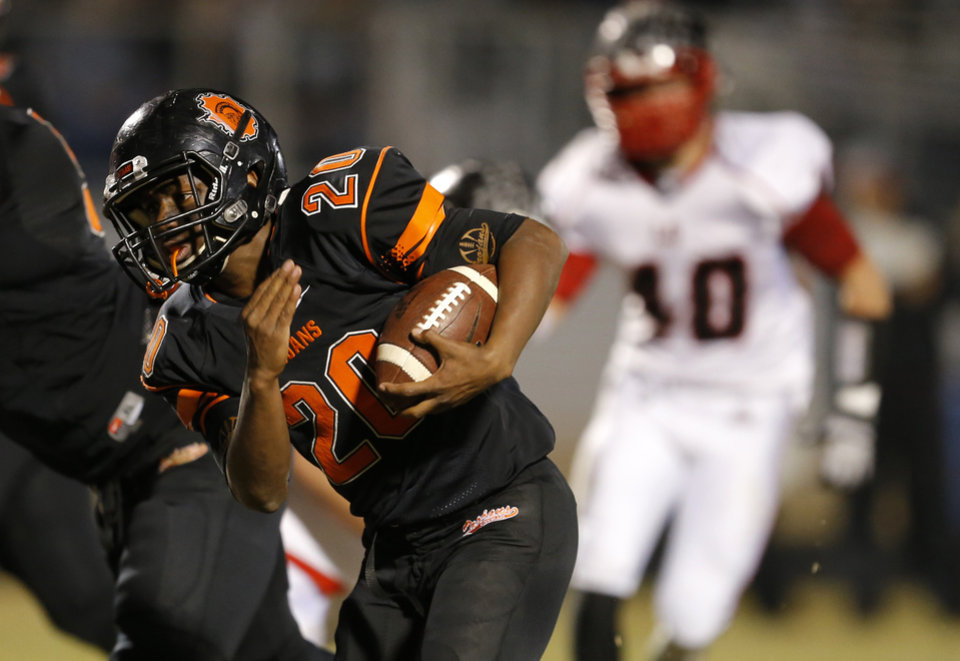 Photo - Douglass' Chris Friday runs for a touchdown against Locust Grrove during their high school football playoff game at Douglass in Oklahoma City, Friday, Nov. 28, 2014. Photo by Bryan Terry, The Oklahoman