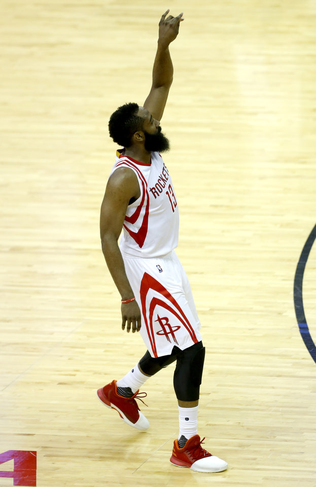 Photo - Houston's James Harden (13) reacts after a basket during Game 2 in the first round of the NBA playoffs between the Oklahoma City Thunder and the Houston Rockets in Houston, Texas,  Wednesday, April 19, 2017.  Photo by Sarah Phipps, The Oklahoman