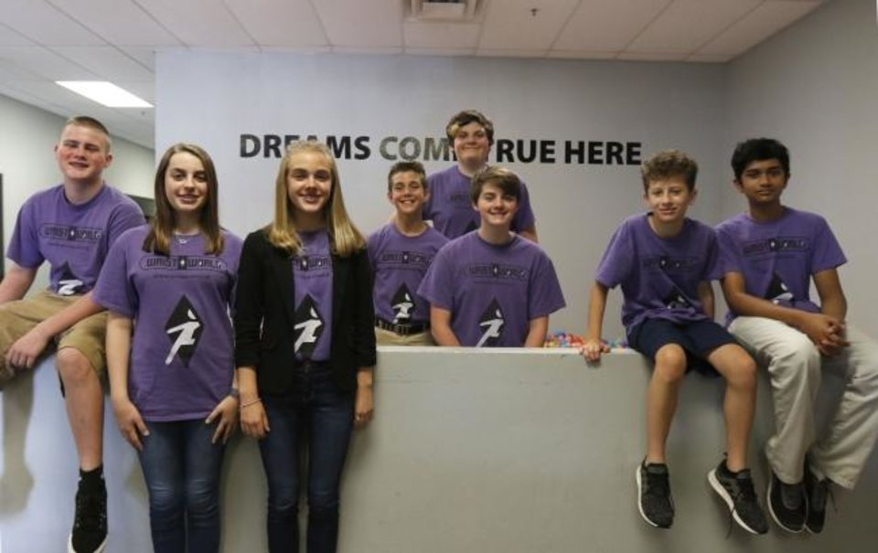 Photo -  From left, Braden Breinholt, Emma Wheelbarger, Katie Sparks, Brad Sparks, Aidan Strother, Gavin Bacon, HJ Gilman and Arya Ramineedi are shown at Loveworks Leadership in Norman where they created the augmented reality game