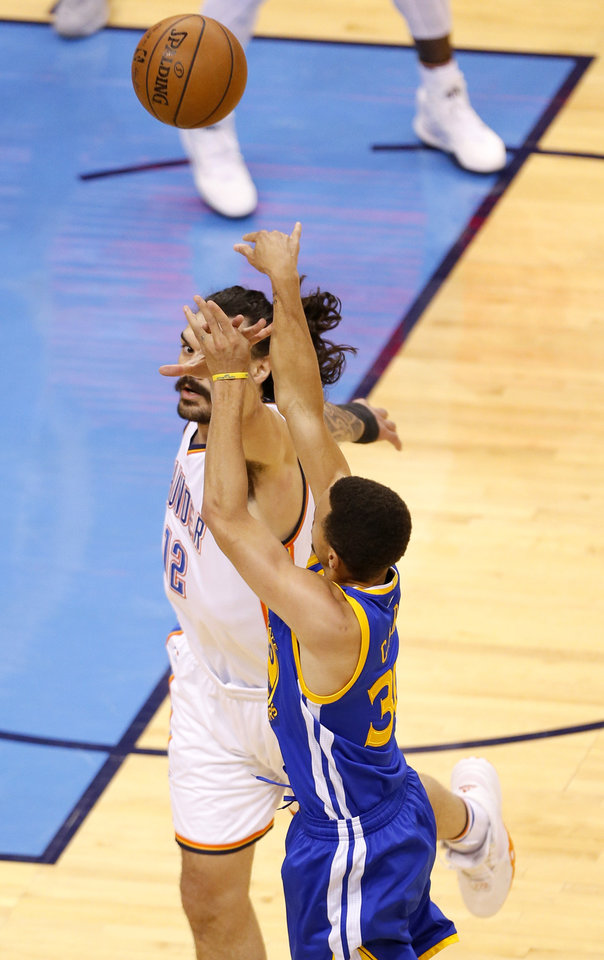 Photo - Oklahoma City's Steven Adams (12) blocks the shot of Golden State 's Stephen Curry (30) during Game 3 of the Western Conference finals in the NBA playoffs between the Oklahoma City Thunder and the Golden State Warriors at Chesapeake Energy Arena in Oklahoma City, Sunday, May 22, 2016. Photo by Sarah Phipps, The Oklahoman