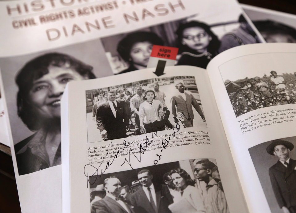 Photo - Diane Nash visited Oklahoma Christian University to speak as part of a history lecture series on Tuesday,  Feb. 21, 2017. Nash co-founded the Student Non-violent Coordinating Committee (SNCC) and led one of the early Freedom Rides during the 1960's to protest segregation. Nash autographed and dated this page in a book about the Freedom Riders that features an old newspaper photograph of her in the Memphis marches.  Photo by Jim Beckel, The Oklahoman