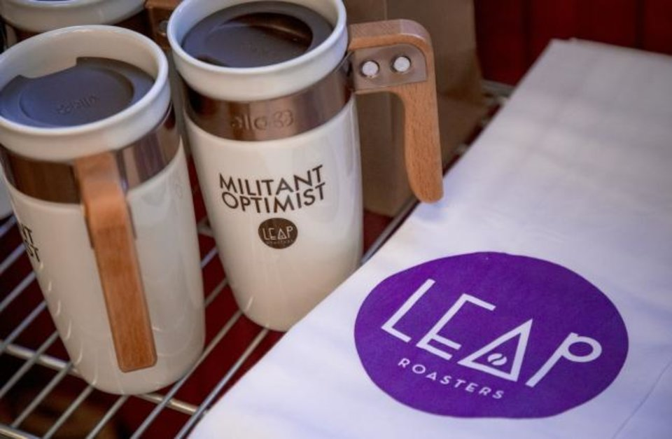 Photo -  Coffee merchandise at LEAP Coffee Roasters on Monday, Jan. 27, 2020, in Oklahoma City, Okla.   [Chris Landsberger/The Oklahoman]