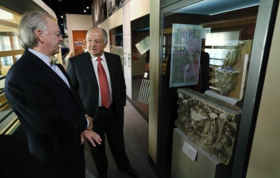 Photo -  Mike McAuliffe, left, and former Oklahoma City Mayor Ron Norick attend the 2013 opening of a MAPS exhibit inside the Oklahoma History Center. [OKLAHOMAN ARCHIVES]