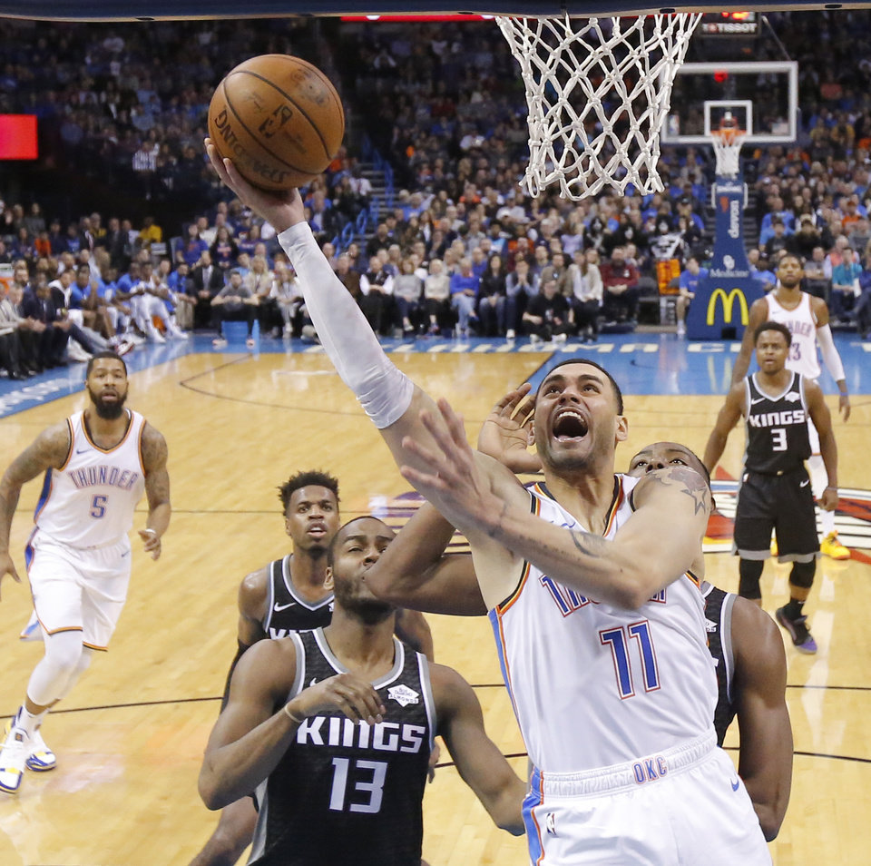 Photo - Oklahoma City's Abdel Nader (11) goes to the basket during an NBA basketball game between the Oklahoma City Thunder and the Sacramento Kings at Chesapeake Energy Arena in Oklahoma City, Saturday, Feb. 23, 2019. Sacramento won 119-116. Photo by Bryan Terry, The Oklahoman