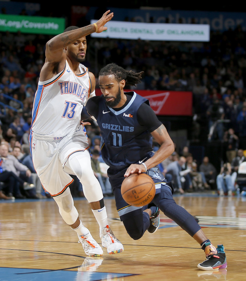 Photo - Oklahoma City s Paul George (13) defends Mike Conley (11) of ed5aa2abf2c