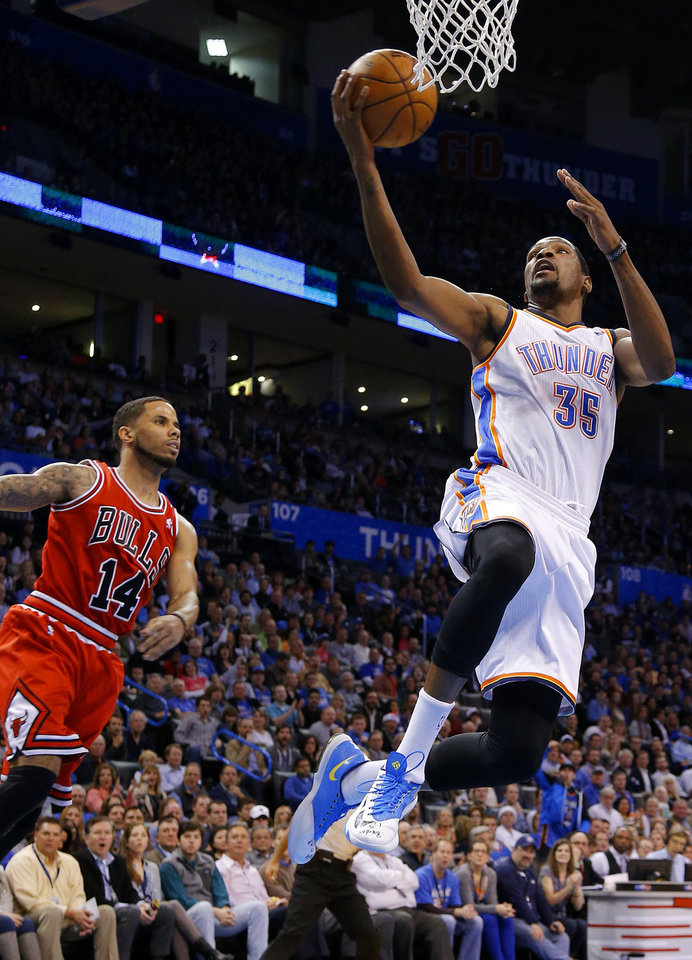 7b214fc42b4 Oklahoma City s Kevin Durant (35) goes to the basket past Chicago s D.J.  Augustin (14) during an NBA basketball game between the Oklahoma City  Thunder and ...