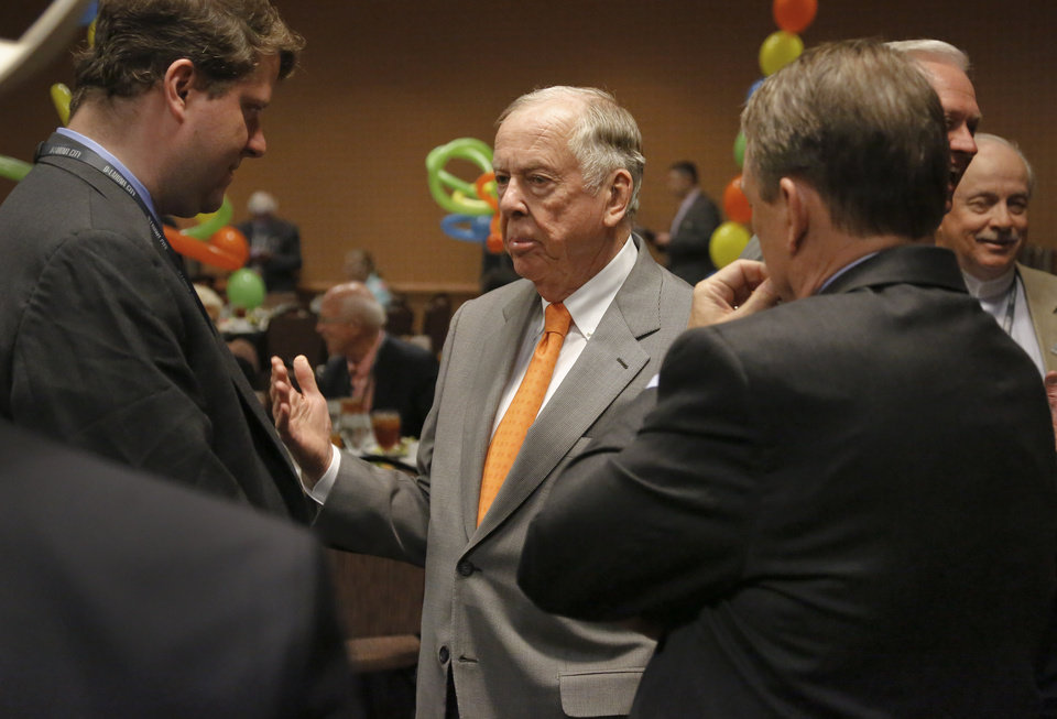 Photo - T. Boone Pickens speaks to party goers at his birthday bash during the Southern Republican Leadership Conference at the Cox Convention Center in Oklahoma City, Okla. on Friday, May 22, 2015.   Photo by Chris Landsberger, The Oklahoman
