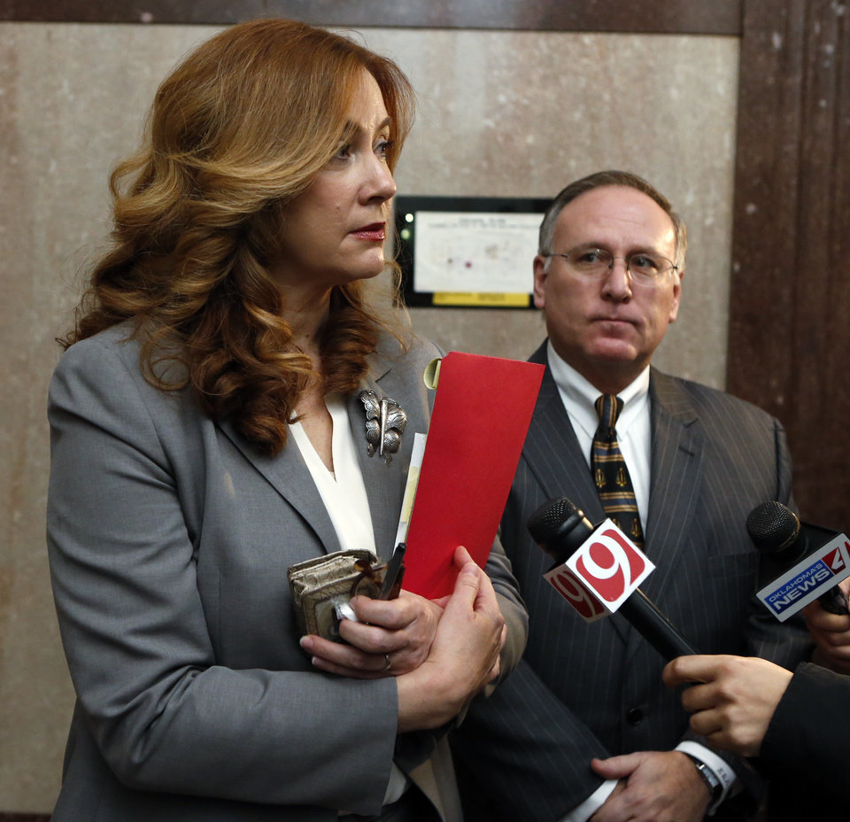Photo -  Prosecutors Suzanne Lavenue and Kirk Martin speak with news reporters following the guilty verdict for Juanita Gomez. [Photo by Steve Sisney, The Oklahoman]
