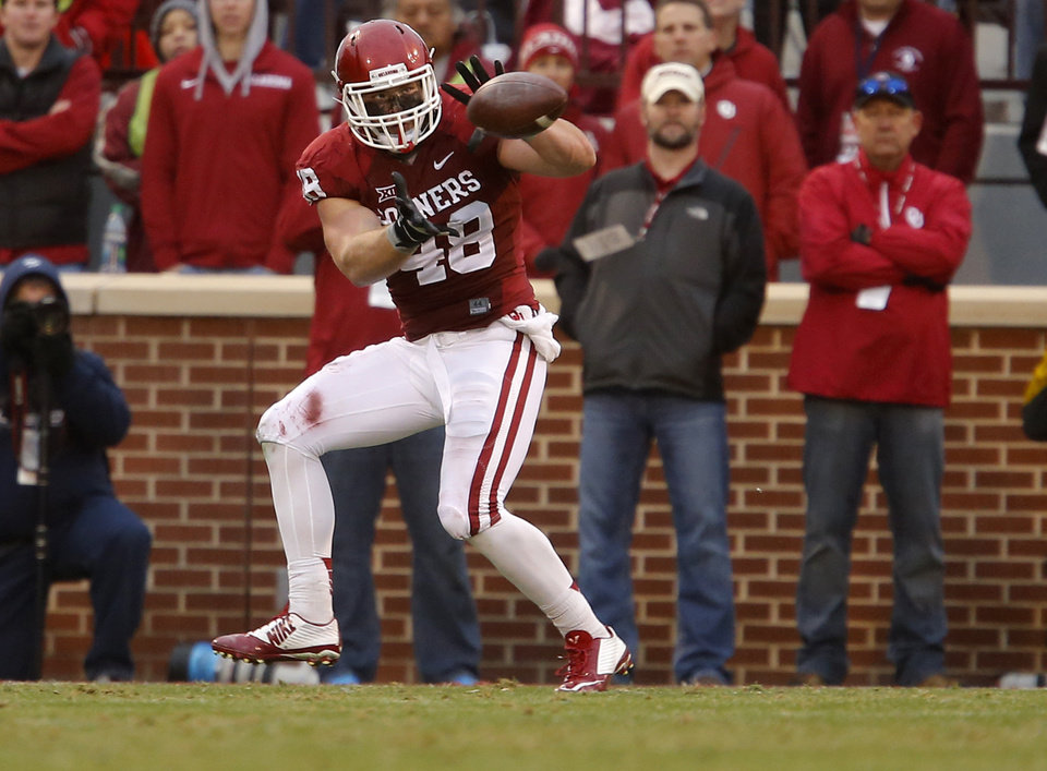 Photo - Oklahoma's Aaron Ripkowski (48) catches a pass for a touchdown during a Bedlam college football game between the University of Oklahoma Sooners (OU) and the Oklahoma State Cowboys (OSU) at Gaylord Family-Oklahoma Memorial Stadium in Norman, Okla., Saturday, Dec. 6, 2014. Photo by Bryan Terry, The Oklahoman