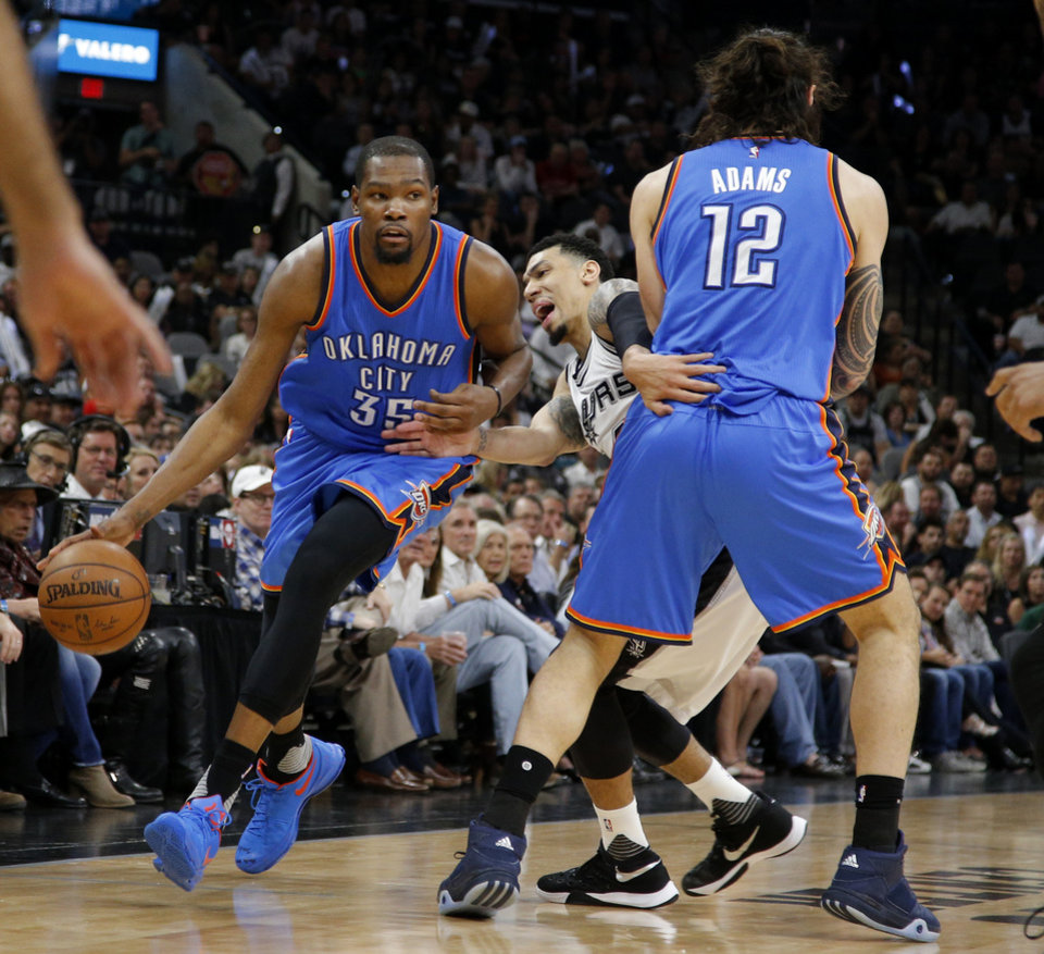 Photo - Oklahoma City's Kevin Durant (35) goes past San Antonio's Danny Green (14) and Steven Adams (12) during Game 5 of the second-round series between the Oklahoma City Thunder and the San Antonio Spurs in the NBA playoffs at the AT&T Center in San Antonio, Tuesday, May 10, 2016. Photo by Bryan Terry, The Oklahoman