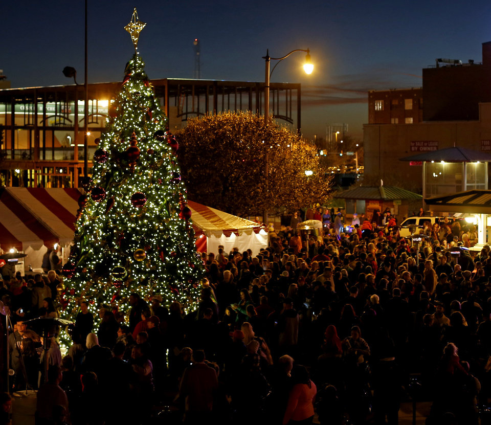 Photo -  A crowd watches as the lights are turned on during the 2014 Bricktown Tree Lighting Festival outside the Chickasaw Bricktown Ballpark in Oklahoma City. [Photo by Bryan Terry, The Oklahoman Archives]
