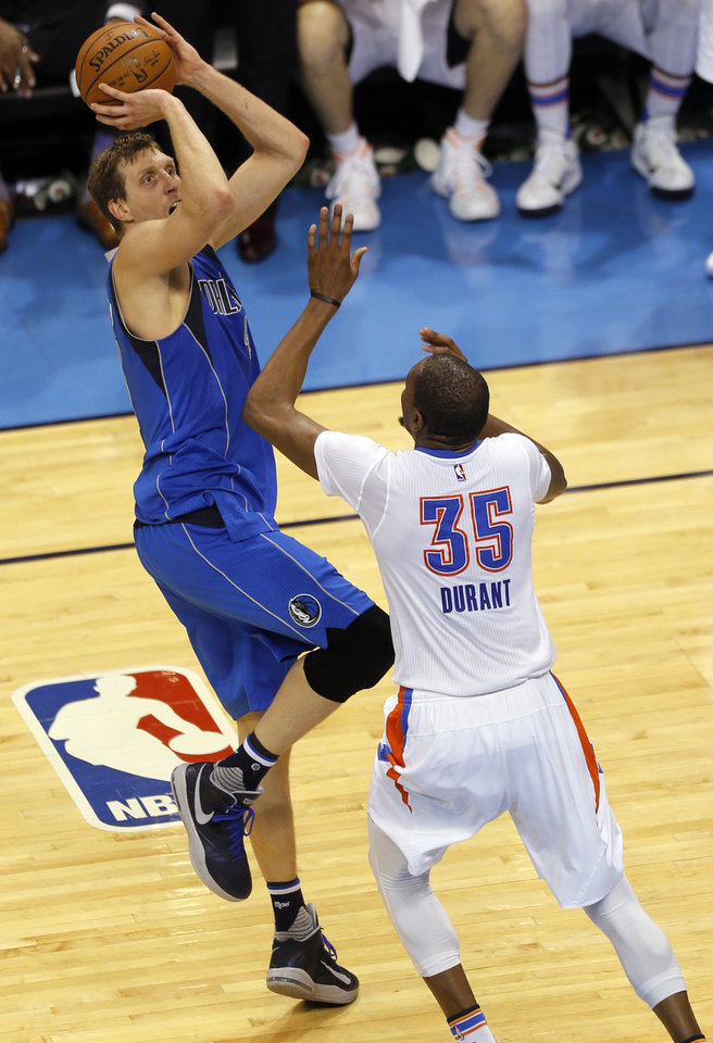 Photo - Dallas' Dirk Nowitzki (41) shoots over Oklahoma City's Kevin Durant (35) during Game 5 of the first round series between the Oklahoma City Thunder and the Dallas Mavericks in the NBA playoffs at Chesapeake Energy Arena in Oklahoma City, Monday, April 25, 2016. Photo by Sarah Phipps, The Oklahoman