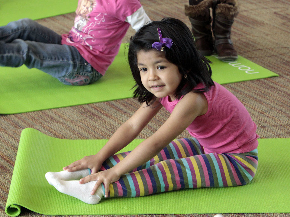Photo - Adilene Soto does a pose as Angela Moorad teaches yoga to three and four-year-olds on Wednesday, March 7, 2012, in Oklahoma City, Okla.  Photo by Steve Sisney, The Oklahoman