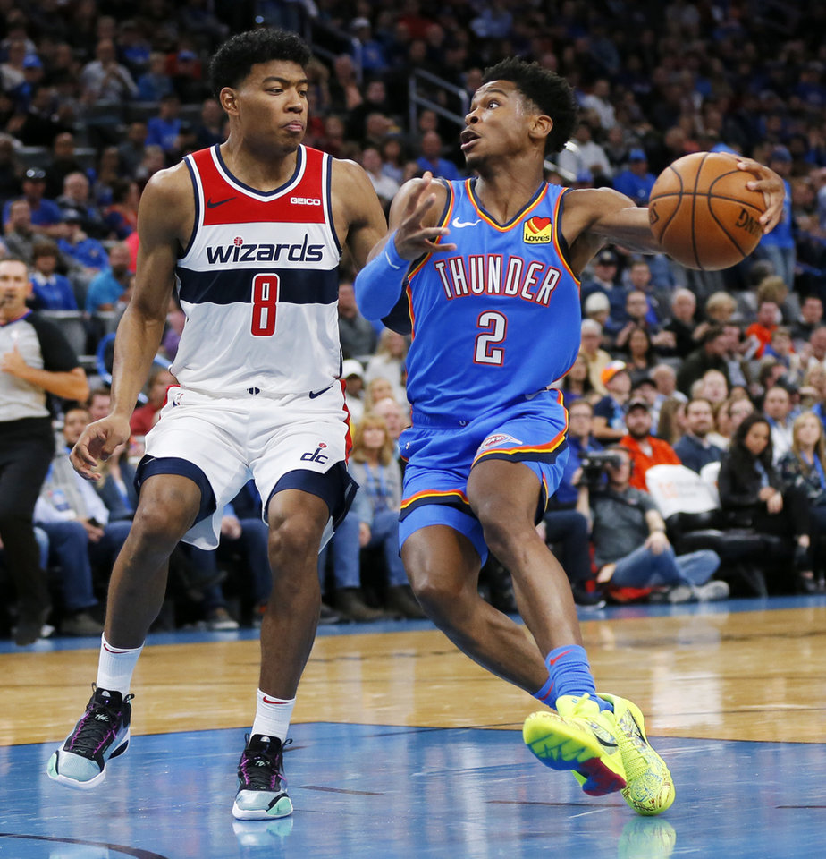 Photo - Oklahoma City's Shai Gilgeous-Alexander (2) drives to the basket next to Washington's Rui Hachimura (8) in the second quarter during an NBA basketball game between the Oklahoma City Thunder and the Washington Wizards at Chesapeake Energy Arena in Oklahoma City, Friday, Oct. 25, 2019. [Nate Billings/The Oklahoman]