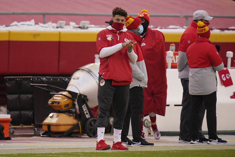 Photo -  Kansas City Chiefs quarterback Patrick Mahomes watches from the sideline during the first half of an NFL football game against the Los Angeles Chargers, Sunday, Jan. 3, 2021, in Kansas City. (AP Photo/Jeff Roberson)