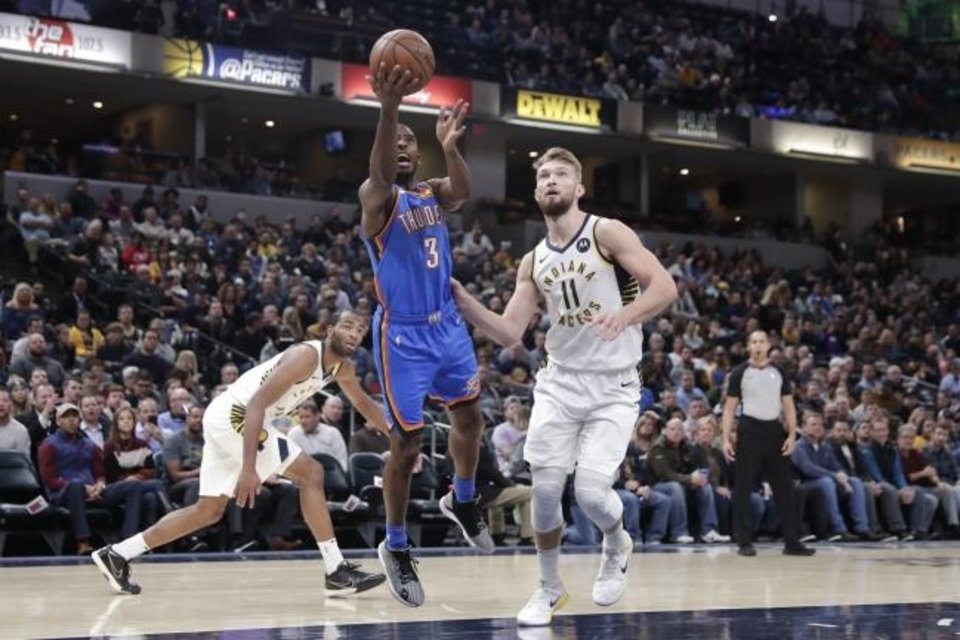 Photo -  Oklahoma City guard Chris Paul (3) shoots next to Indiana Pacers forward Domantas Sabonis (11) during Tuesday night's game in Indianapolis. [AP Photo/Michael Conroy]