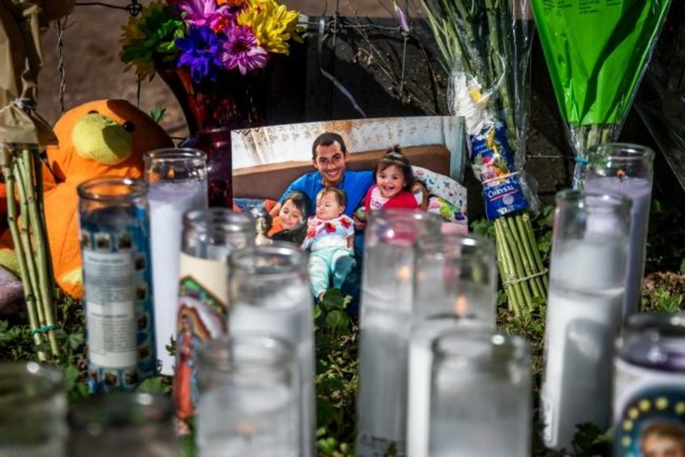 Photo -  The three children, 3-year-old Zane Ezri Henry, 23-month-old Mireya Henry and 6-month-old Catalaya Kyeana Rios, who police say were killed by their mother, are seen in a picture with their father at their memorial on Thursday in Phoenix. [Arizona Republic]