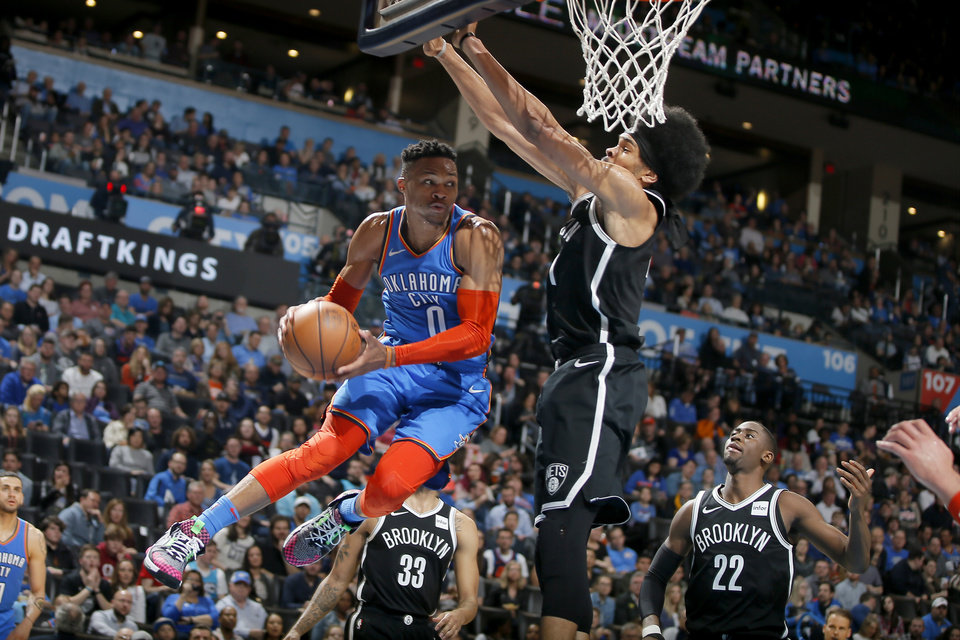 Photo - Oklahoma City's Russell Westbrook (0) passes the ball as Brooklyn's Jarrett Allen (31) defends during an NBA basketball game between the Oklahoma City Thunder and the Brooklyn Nets at Chesapeake Energy Arena in Oklahoma City, Wednesday, March 13, 2019. Oklahoma City won 108-96. Photo by Bryan Terry, The Oklahoman