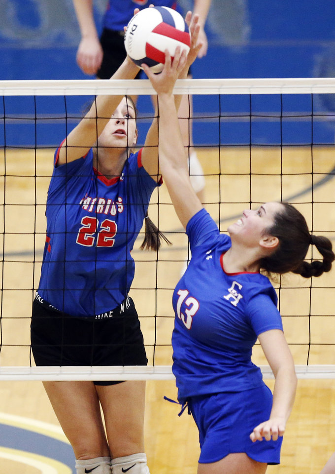 Photo - Southwest Covenant's Kylie Moseley (22) tries to block Christian Heritage's London Roberts (13) during a Class 4A quarterfinal game in the state volleyball tournament between Christian Heritage Academy and Southwest Covenant at Choctaw High School in Choctaw, Okla., Friday, Oct. 11, 2019. [Nate Billings/The Oklahoman]