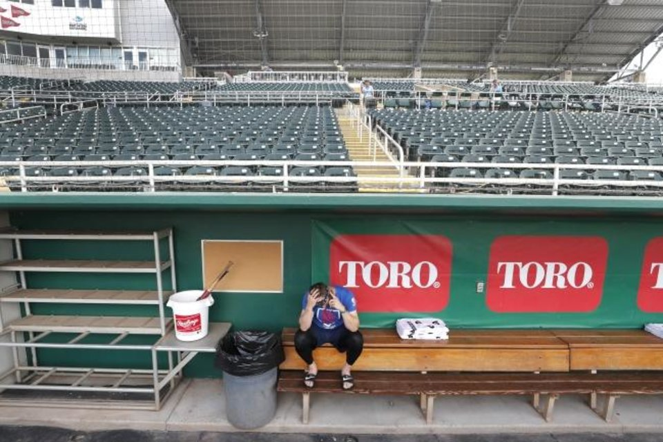 Photo -  Minnesota Twins catcher Mitch Garver talks on his phone in an empty Hammond Stadium on March 12 in Fort Myers, Fla. [AP Photo/Elise Amendola]