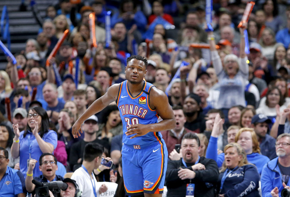 Photo - Oklahoma City's Deonte Burton (30) celebrates a basket during the NBA basketball game between the Oklahoma City Thunder and the Portland Trail Blazers at the Chesapeake Energy Arena in Oklahoma City, Saturday, Jan. 18, 2020.  [Sarah Phipps/The Oklahoman]