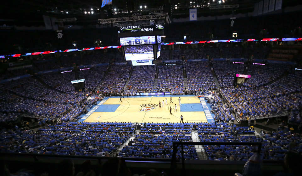 Photo - Fans cheer during Game 4 in the first round of the NBA playoffs between the Portland Trail Blazers and the Oklahoma City Thunder at Chesapeake Energy Arena in Oklahoma City, Sunday, April 21, 2019.  Photo by Sarah Phipps, The Oklahoman