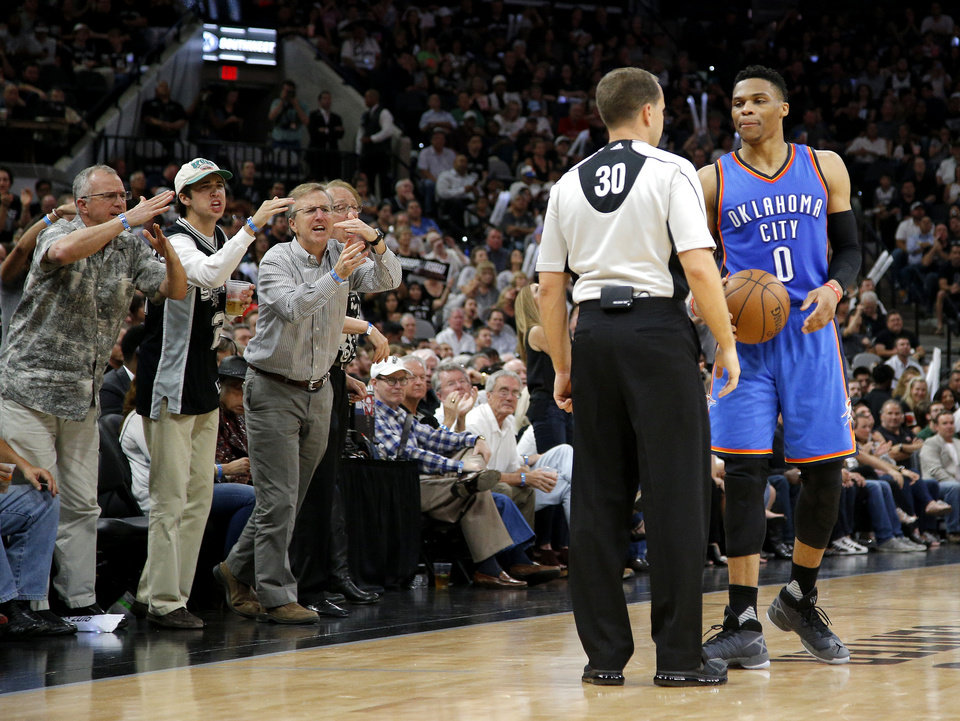 Photo - Fans shout as Oklahoma City's Russell Westbrook (0) talks with an official during Game 5 of the second-round series between the Oklahoma City Thunder and the San Antonio Spurs in the NBA playoffs at the AT&T Center in San Antonio, Tuesday, May 10, 2016. Oklahoma City won 95-91. Photo by Bryan Terry, The Oklahoman