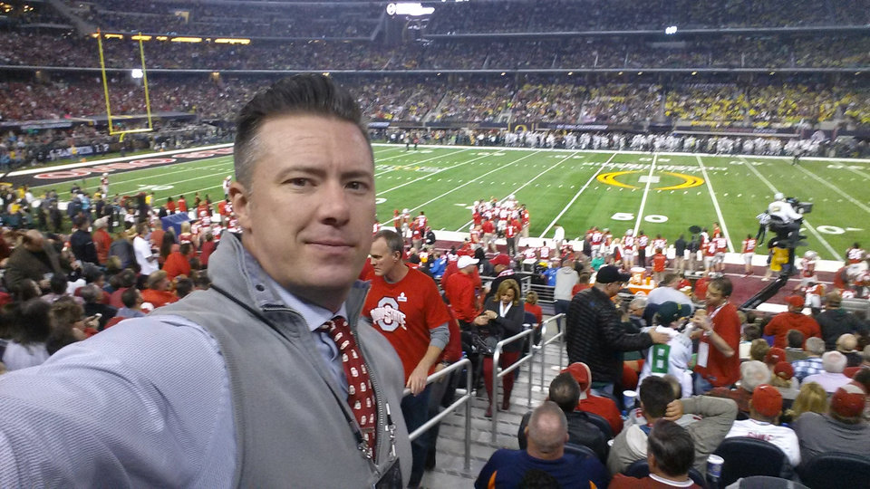 Photo -  Oklahoma native Jason W. Taylor is a college football diehard. An unexpected email led to the software developer's company being selected to build a system for the College Football Playoff. Last year, he attended the national championship game between Ohio State and Oregon. [PHOTO PROVIDED]