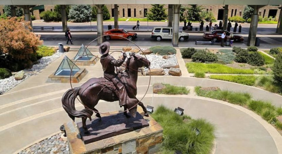 Photo - Statue of Oklahoma favorite son and humorist Will Rogers at Will Rogers World Airport in southwest Oklahoma City  on Thursday, June 9, 2016.   Photo by Jim Beckel, The Oklahoman